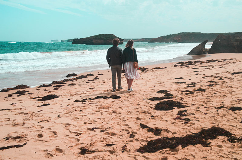 couple walking along beach bay of islands great ocean road victoria