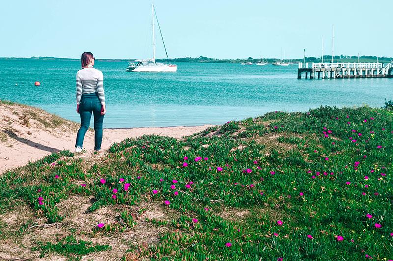 girl walking along beach at pier on phillip island near melbourne victoria