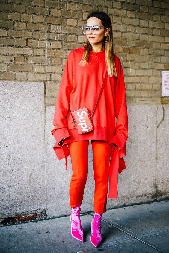 styling red trend for winter red oversized sweatshirt red trousers velvet hot pink ankle boots