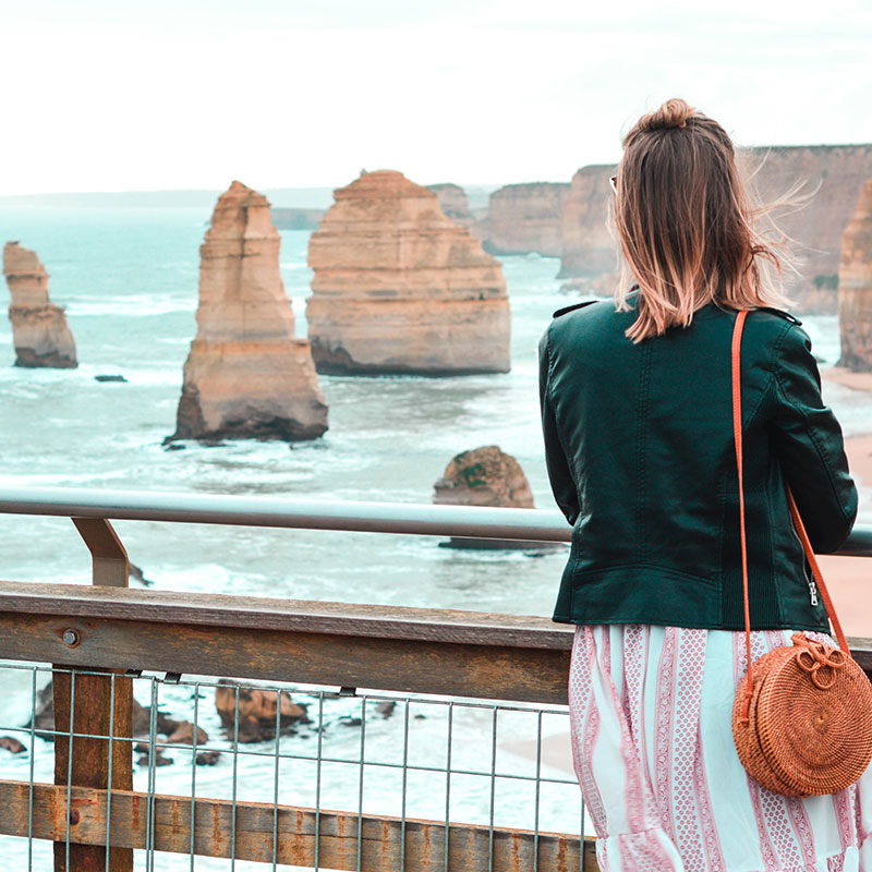 girl looking out to twelve apostles from view point great ocean road australia