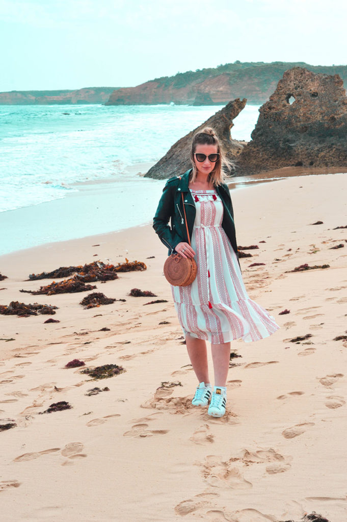 girl on beach bay of islands great ocean road victoria wearing boho dress leather jacket round basket bag summer outfit idea