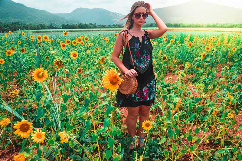 boho floral dress in field of sunflowers rachel holliday the daily luxe