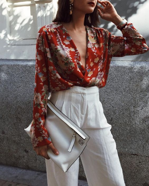 red floral draped wrap shirt with highwaist white trousers and white oversized clutch