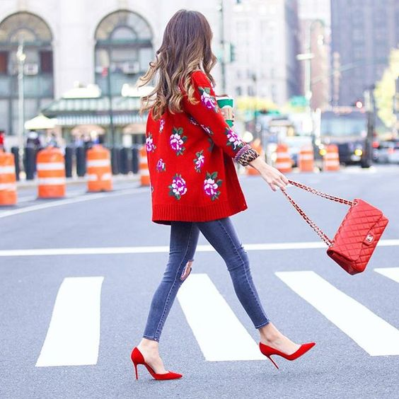 floral red oversized cardigan with slim fit jeans red pump heels red chanel bag autumn outfit