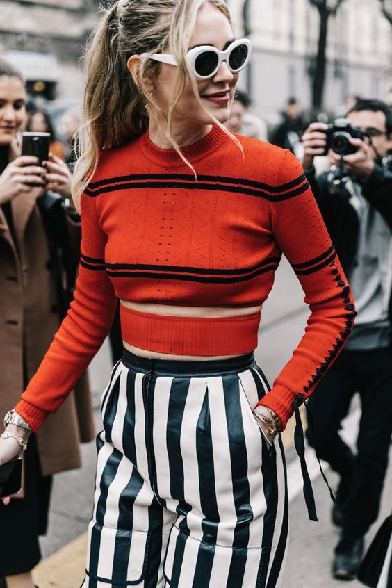 red stripe jumper top and monochrome striped trousers with retro white sunglasses fashion week street style