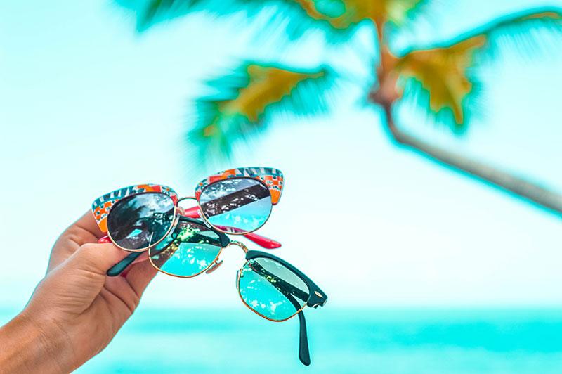 Dolce & Gabanna Sicilian Taste and Ray-Ban Folding Clubmaster sunglasses on tropical beach summer vibes