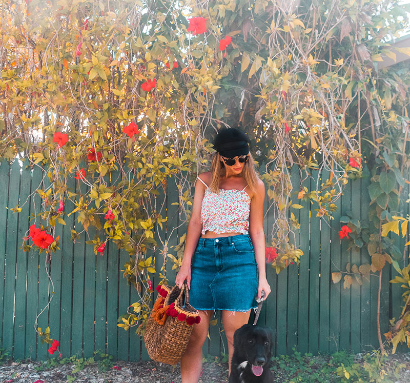cairns fashion blogger rachel holliday wearing floral crop top denim skirt baker boy hat with cute dog