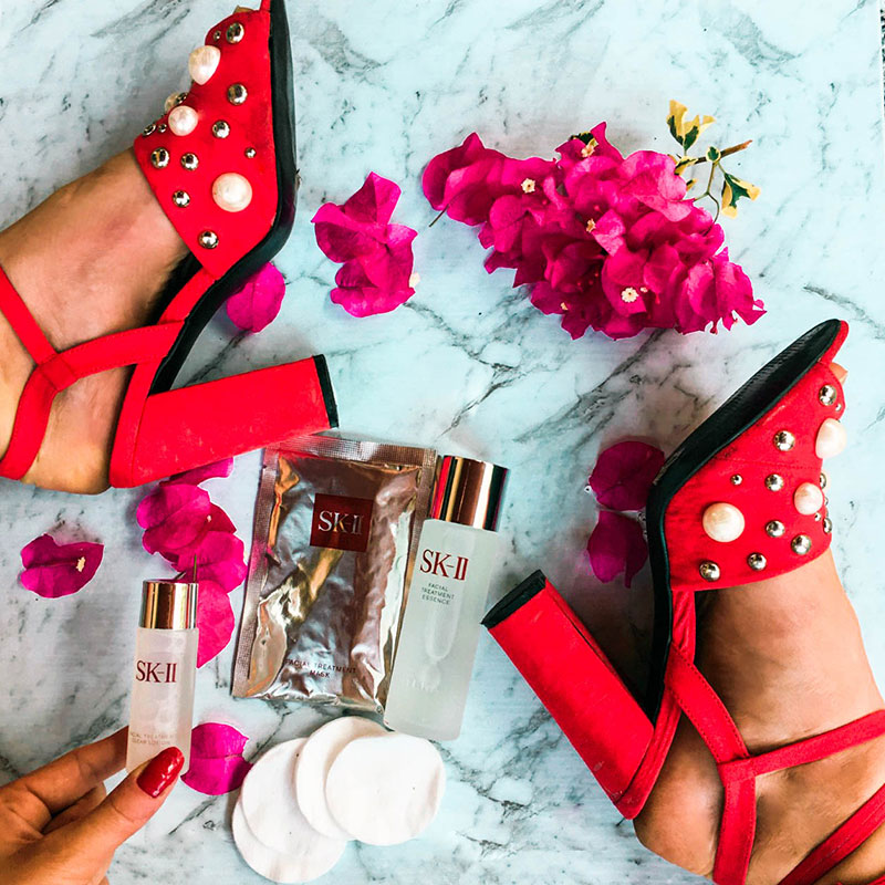 pearl embellished red block heels in marble instagram flatlay