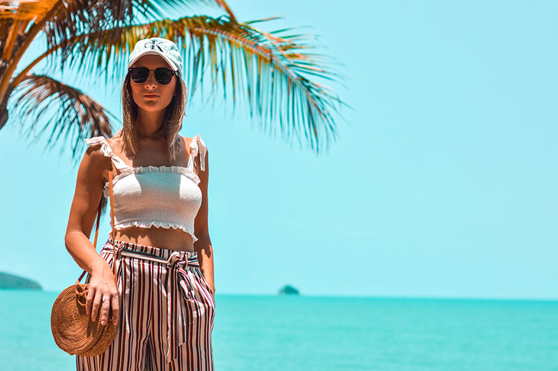 australian summer beach outfit white shirred crop top calvin klein denim cap round basket bag pinstripe high waist culottes