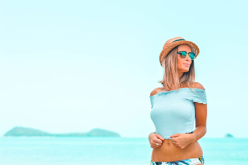 australian summer outfit shirred crop top on beach with bikini ray ban clubmaster the daily luxe summer fashion blogger outfit