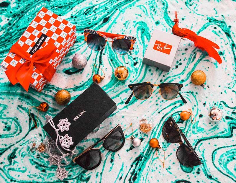 christmas gift ideas for beach lover prada ray ban dolce gabbana sunglasses flatlay