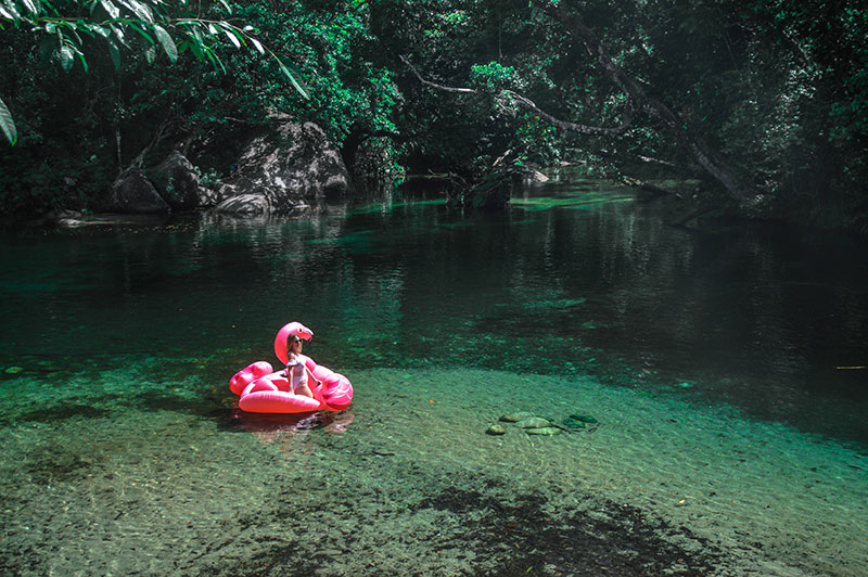 the daily luxe fashion blogger on inflatable flamingo at babinda boulders cairns far north queensland