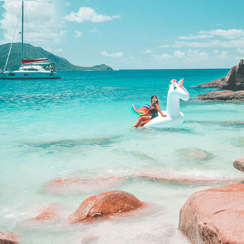 fashion blogger instagram on inflatable unicorn trendy pool float in sea fitzroy island