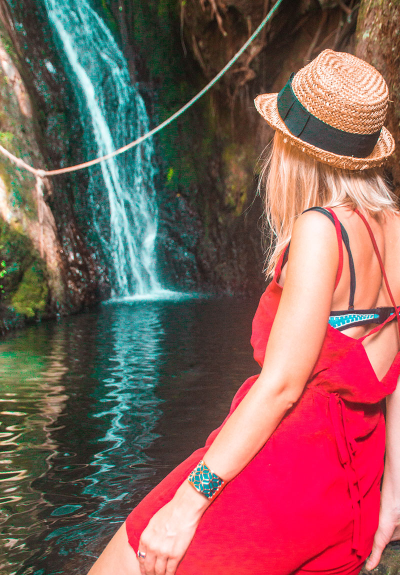the daily luxe cairns fashion blogger at Fairy Falls crystal cascades tropical north queensland instagram wearing straw hat red jumpsuit blue rose gold bangle