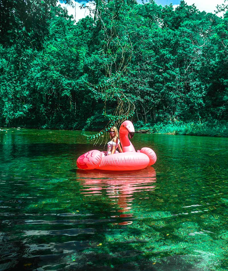 wanderlust travel goals girl on inflatable flamingo babinda boulders far north queensland australia