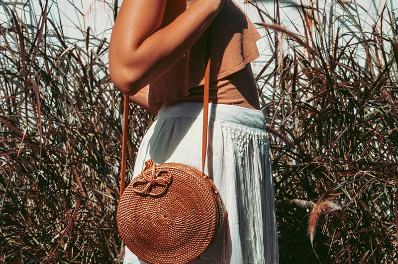 round rattan basket bag in neutral boho outfit with tanned skin boho instagram outfit