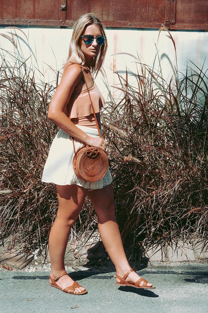 neutral boho style one shoulder nude top crochet shorts round basket bag