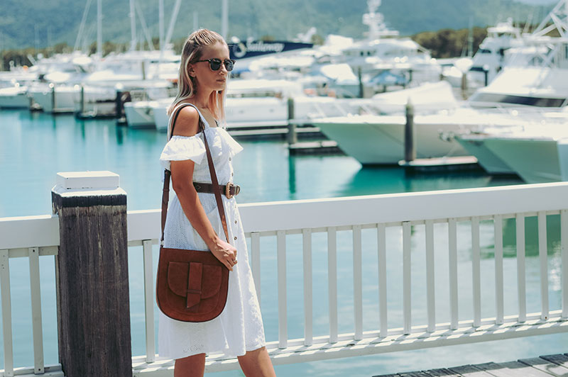 white dress summer outfit off shoulder white dress with boho belt tan leather handbag