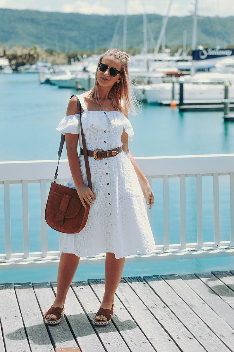 white off shoulder button up midi dress with boho brown belt tan leather bag and leather shoes cute summer outfit the daily luxe