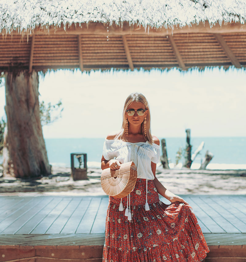 the daily luxe boho style blogger wearing auguste boho maxi skirt kivari top cult gaia bag summer boho chic outfit