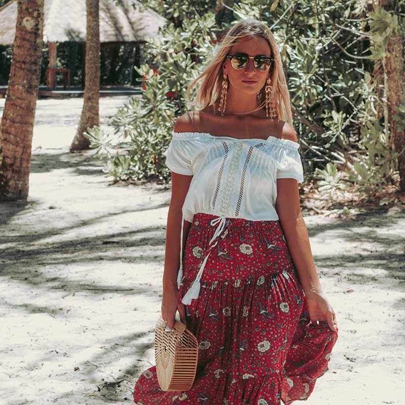 australian boho style blogger boho chic outfit arhem off shoulder top auguste floral maxi skirt cult gaia bag the daily luxe photographed on cairns beach