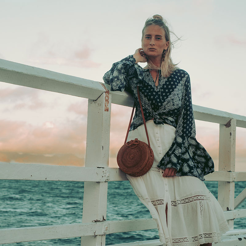 boho summer outfit paisley print bell sleeved top and lace midi skirt and basket bag the daily luxe australian fashion blog