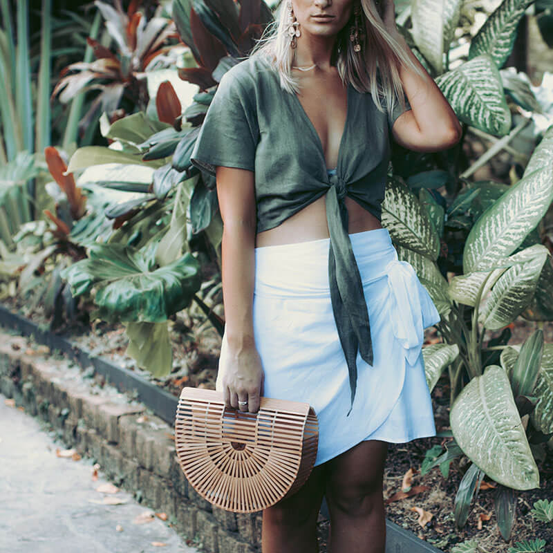 linen trend outfit details khaki crop linen tie top and wrap white linen skirt