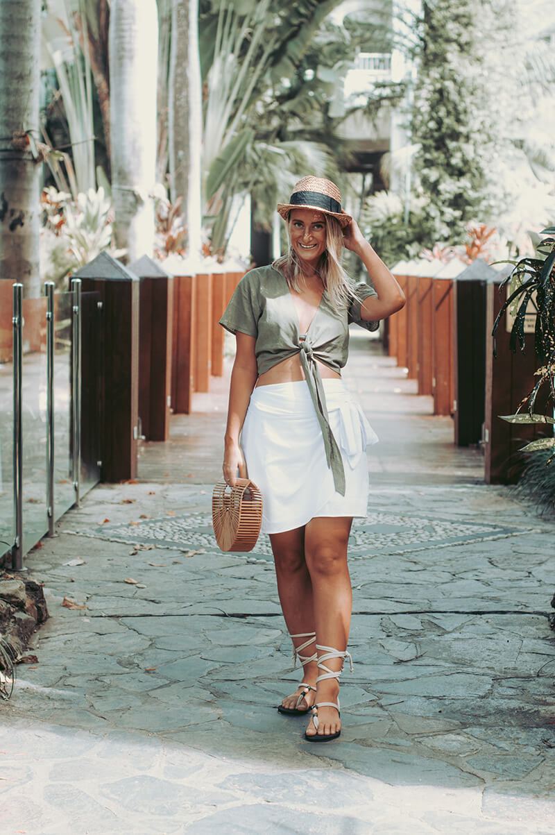 linen outfit idea crop tie top and wrap skirt summer outfit the daily luxe