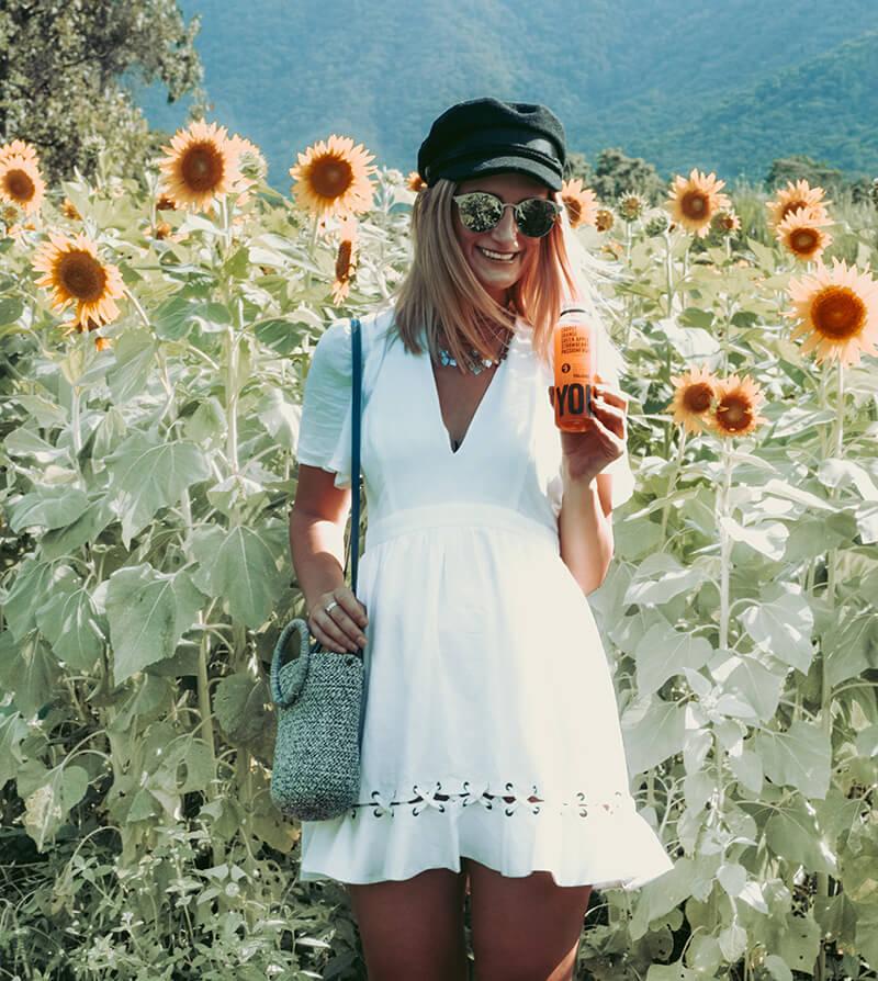 white linen dress summer outfit isla tallulah cairns sunflower fields