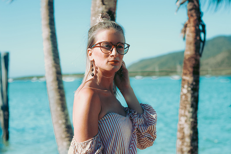 2018 outfit with trendy glasses tortoiseshell cat eye glasses styled with drop earrings and off shoulder top