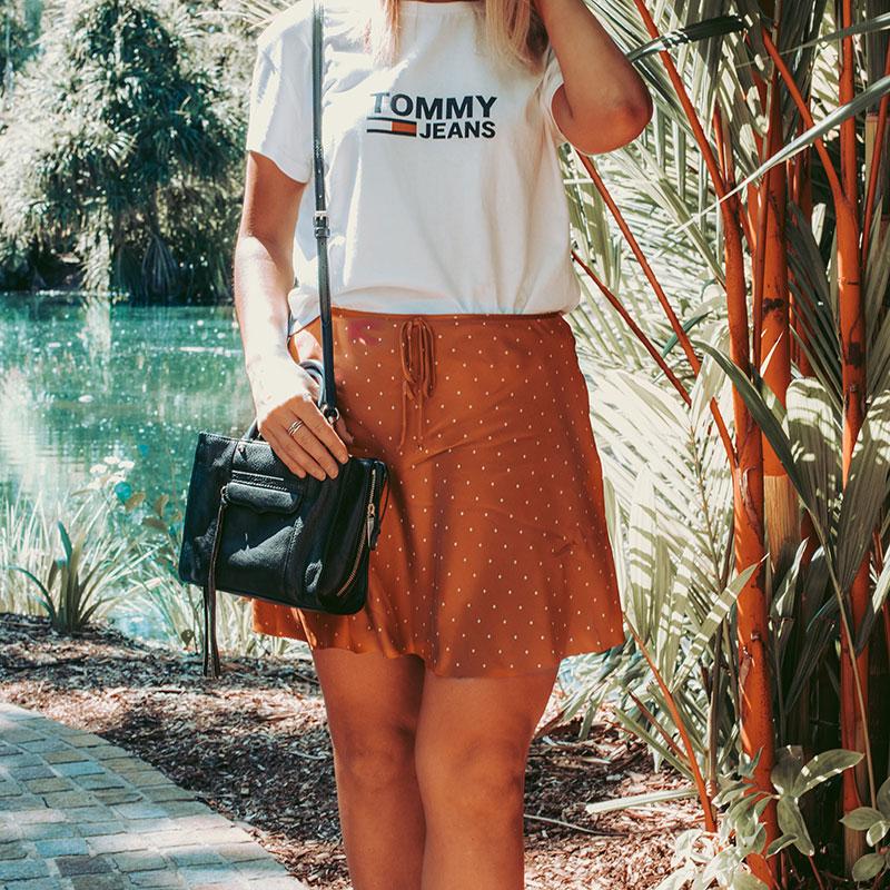 fashion blogger summer outfit details red polka dot skirt tommy hilfiger tee and black rebecca minkoff bag