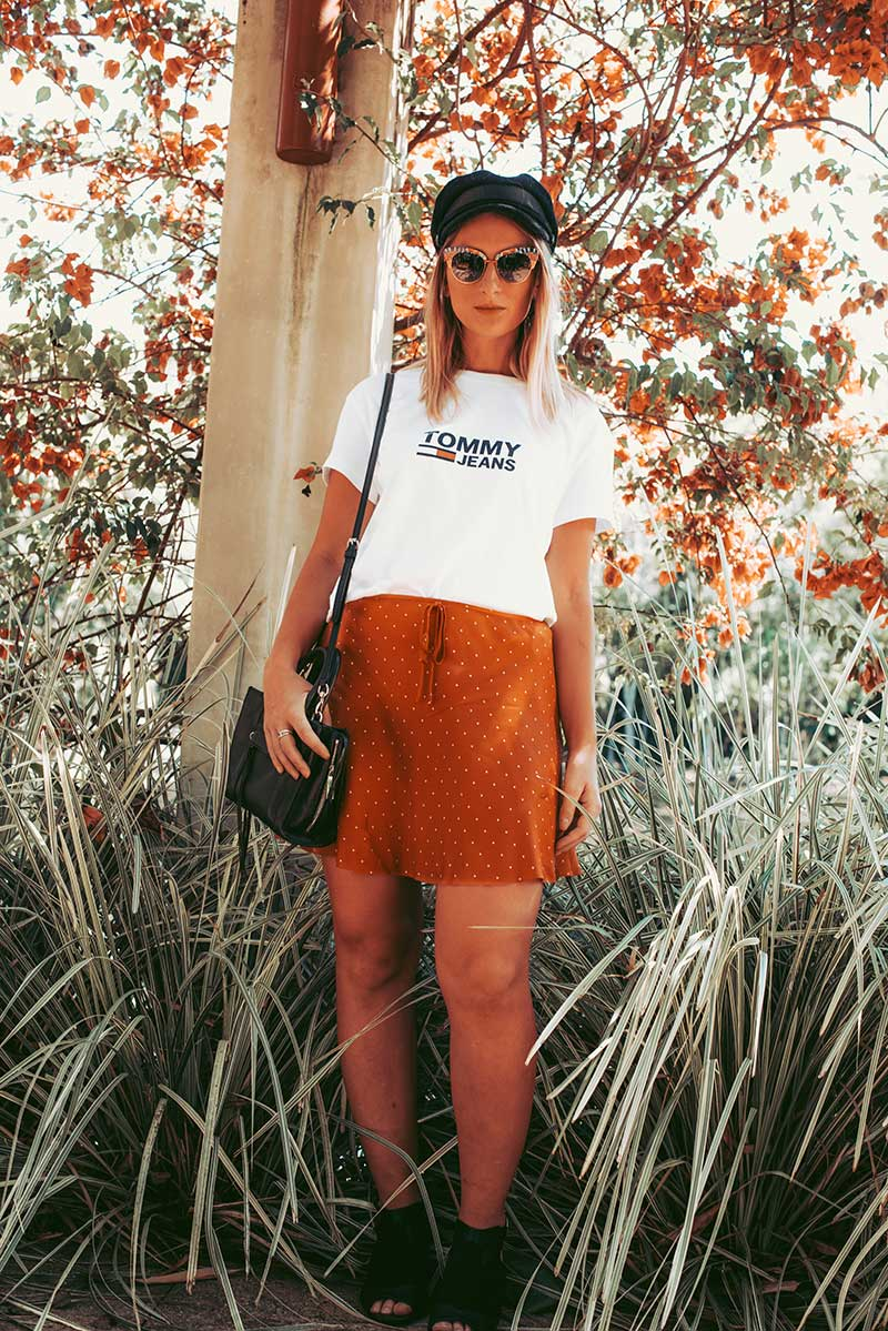 australian fashion blogger wears tommy hilfiger t shirt polka dot skirt and black boho ankle boots