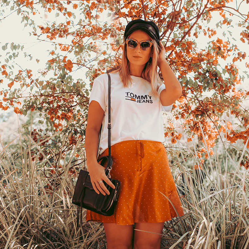 cairns fashion blogger the daily luxe wears red polkadot skirt and baker boy hat