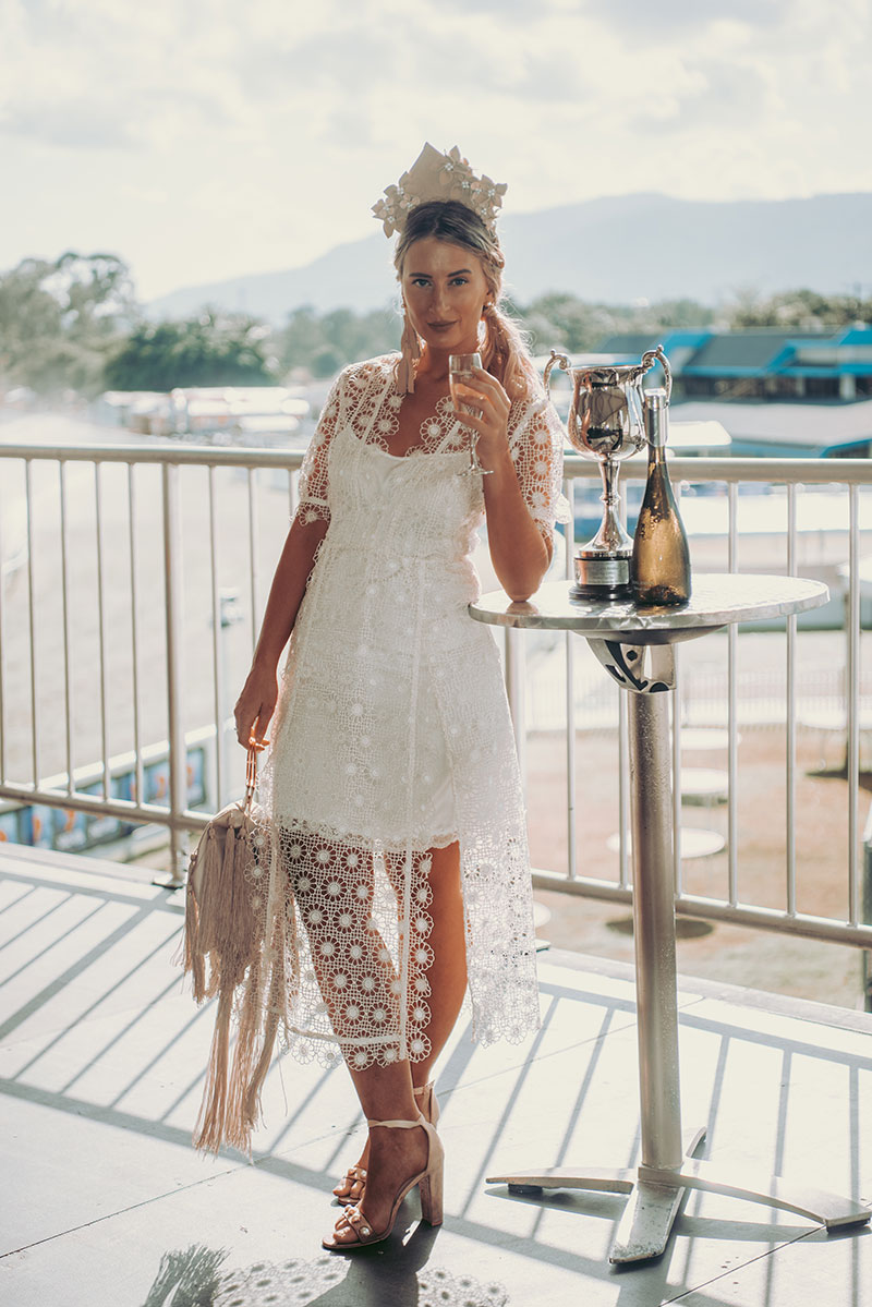 fashion blogger the daily luxe at the cairns amateurs wearing alice mccall lace dress leather crown hair piece fringe bag