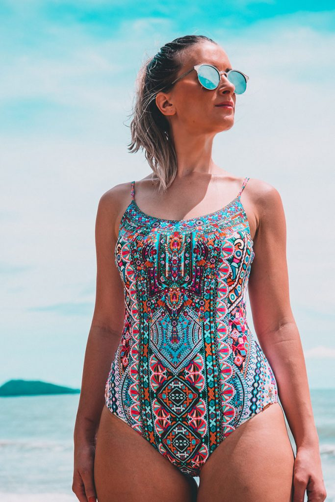 girl wears Camilla Queen Kalbelia one piece swimsuit on Tropical beach near cairns