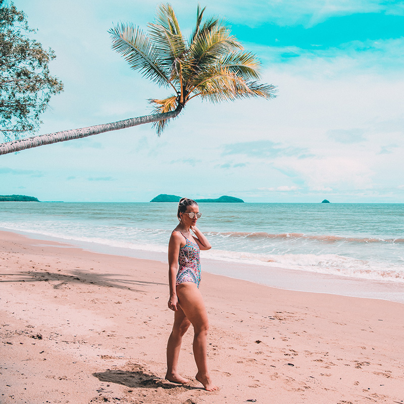 curvy size 10 girl wears camilla one piece swimsuit at cairns beach