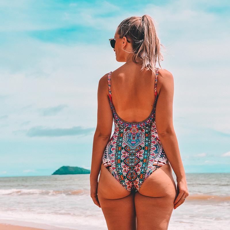 curvy fashion blogger wears camilla one piece on beach