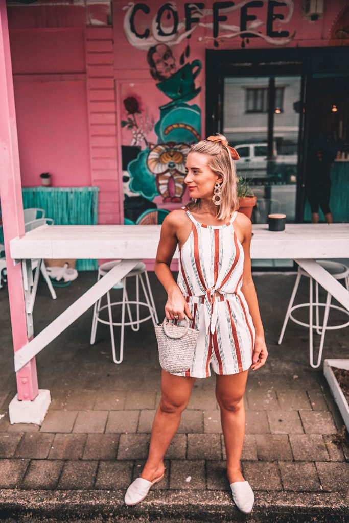 cute summer outfit for 2019 striped playsuit with statement earrings and basket bag