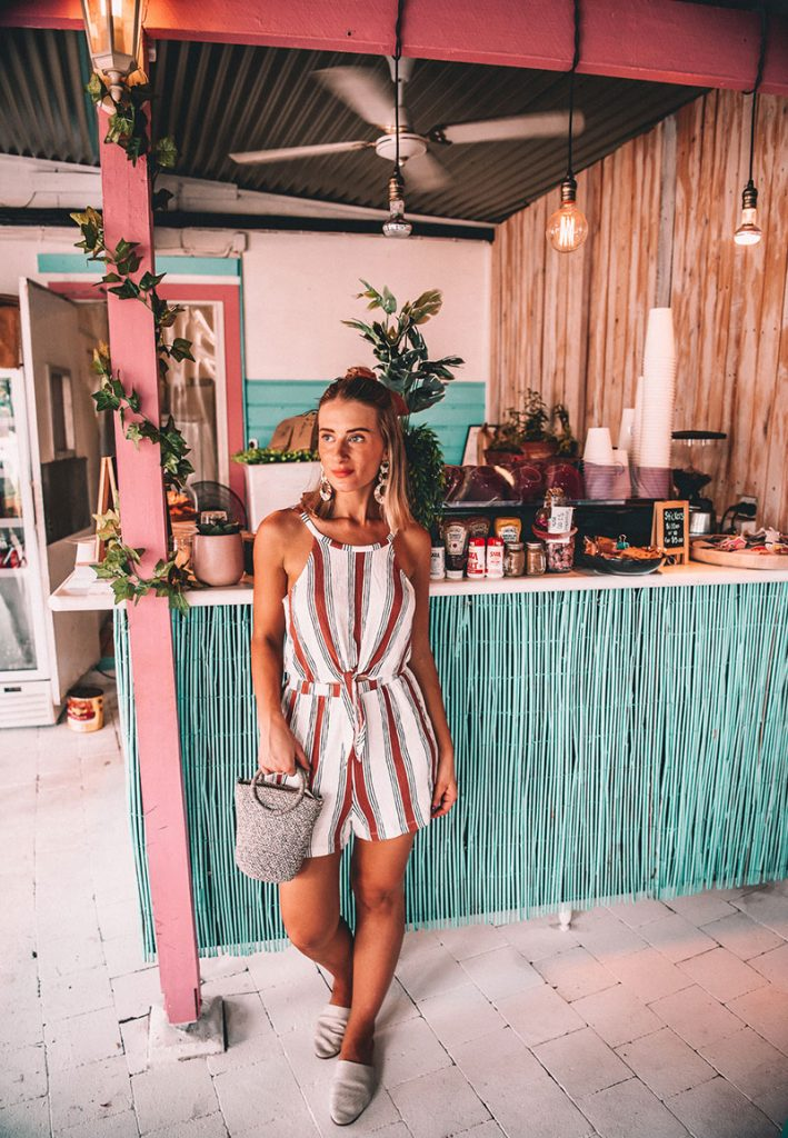 cairns fashion blogger the daily luxe wears striped playsuit vintage circle earrings and woven bag at mayhem at machans cafe